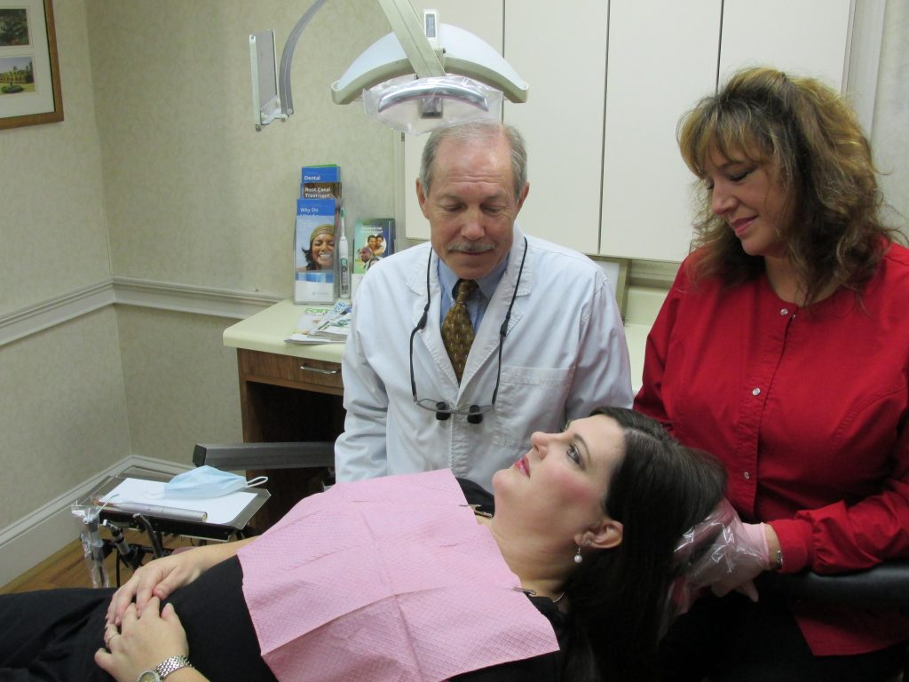 Preventative dentistry, Dr. Rice with dental hygienist and patient